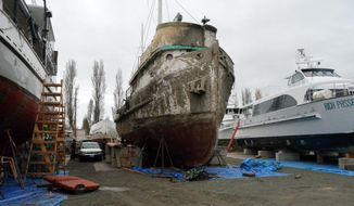 In this Jan. 10, 2014 photo, the Western Flyer, a vessel made famous by author John Steinbeck, sits at a Port Townsend, Wash., boat yard. Salinas, Calif., businessman Gerry Kehoe and owner of the vessel, says he plans to dissemble the derelict and move it to Salinas as a museum and tribute to Steinbeck. (AP Photo/The Peninsula Daily News, Charlie Bermant)
