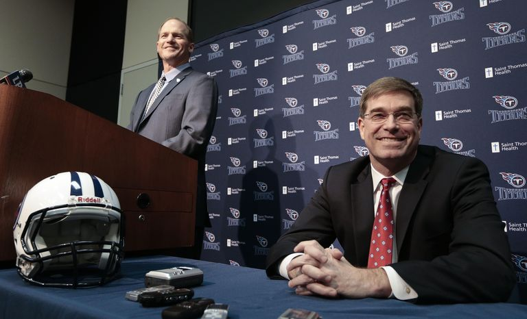Tennessee Titans head coach Ken Whisenhunt, left, answers questions at a news conference with general manager Ruston Webster, right, Tuesday, Jan. 14, 2014, in Nashville, Tenn. The Titans introduced Whisenhunt Tuesday as their 17th head coach and only their third different coach since moving from Houston to Tennessee. (AP Photo/Mark Humphrey)