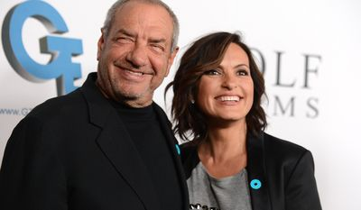 "FILE - This Sept. 26, 2013 file photo shows Dick Wolf, left, and actress Mariska Hargitay from ""Law & Order: Special Victims Unit"" arrive at JoyROCKS launch of the No More PSA Campaign in Los Angeles. Wolf's ""Law & Order: Special Victims Unit"" is in its 15th season, airing Wednesdays at 9 p.m. EST on NBC. (Photo by Jordan Strauss/Invision/AP)"