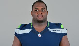 FILE - This is a 2013 file photo of Brandon Mebane of the Seattle Seahawks NFL football team. Mebane is a Seattle original, drafted in the third round by the Seahawks in 2007 and now one win away from helping get the franchise to the Super Bowl. (AP Photo, File)