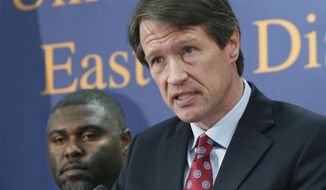 Benjamin Wagner, the United States Attorney for the Eastern District of California, discusses the federal crackdown on the surge of thefts from mailboxes across the Central Valley, during a news conference in Sacramento, Calif.,  Wednesday, Jan. 15, 2014. At left is Dr. Gregory Campbell Jr, deputy chief inspector for Western Field Operations.(AP Photo/Rich Pedroncelli) ** FILE **