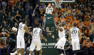 Florida State forward Okaro White (10) goes to the basket against Miami during the first half of an NCAA basketball game in Coral Gables, Fla., Wednesday, Jan. 15, 2014. (AP Photo/Alan Diaz)