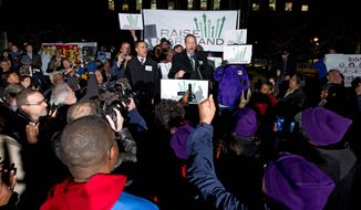 Gov. Martin O'Malley accompanied by Lt. Gov. Anthony Brown speaks during a rally asking to rise the state's minimum wage on Tuesday. Six Flags amusement park in Prince George's County is seeking an exemption. (associated press photographs)