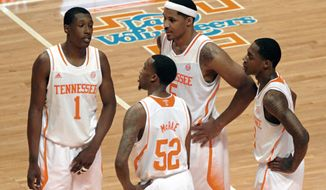 Tennessee guard Josh Richardson (1), guard Jordan McRae (52), forward Jarnell Stokes (5) and guard Antonio Barton (2), from left, relax in the final minute of an NCAA basketball game while holding a comfortable lead against Auburn at the Thompson-Boling Arena in Knoxville, Tenn. on Wednesday, Jan. 15, 2014. Tennessee won 78-67. (AP Photo/Knoxville News Sentinel, Adam Lau)