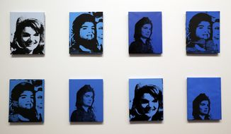 "An Andy Warhol exhibit entitled ""Jackie"" a series of photos of former First Lady Jacqueline Kennedy, is seen in a media tour Wednesday, Jan. 15, 2014, at The Dali Museum in St. Petersburg, Fla. ""Warhol: Art. Fame. Mortality."" opens to the public on Jan. 18 and runs until April 27, 2014. (AP Photo/Chris O'Meara)"