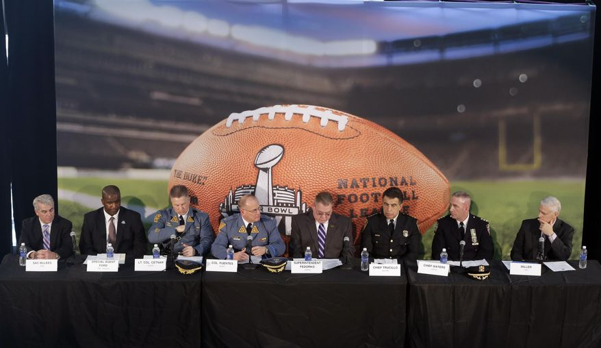 Officials, from left, Homeland Security Investigations special agent in charge Andrew McLees, FBI special agent in charge Aaron Ford, New Jersey State Police Lt. Col. Edward Cetnar, New Jersey State Police Col. Rick Fuentes, Port Authority Police Department Superintendent Michael Fedorko, New Jersey Transit Police Chief Christopher Trucillo, New York Police Department Chief James Waters and NFL chief security officer Jeffrey Miller sit together during a news conference highlighting the security measures set for Super Bowl XLVIII at MetLife Stadium, Wednesday, Jan. 15, 2014, in East Rutherford, N.J. Police officials say security for the Super Bowl will include about 4,000 government and private officers assigned to the stadium on game day. Fans arriving at the game by mass transit on Feb. 2 will encounter a security perimeter extending 300 feet from entrances to the stadium. They'll be funneled into temporary pavilions for airport-style screening. (AP Photo/Julio Cortez)