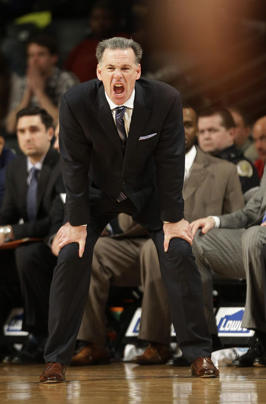 Pittsburgh head coach Jamie Dixon yells to his players in the second half of an NCAA college basketball game against the Georgia Tech, Tuesday, Jan. 14, 2014, in Atlanta. (AP Photo/John Bazemore)