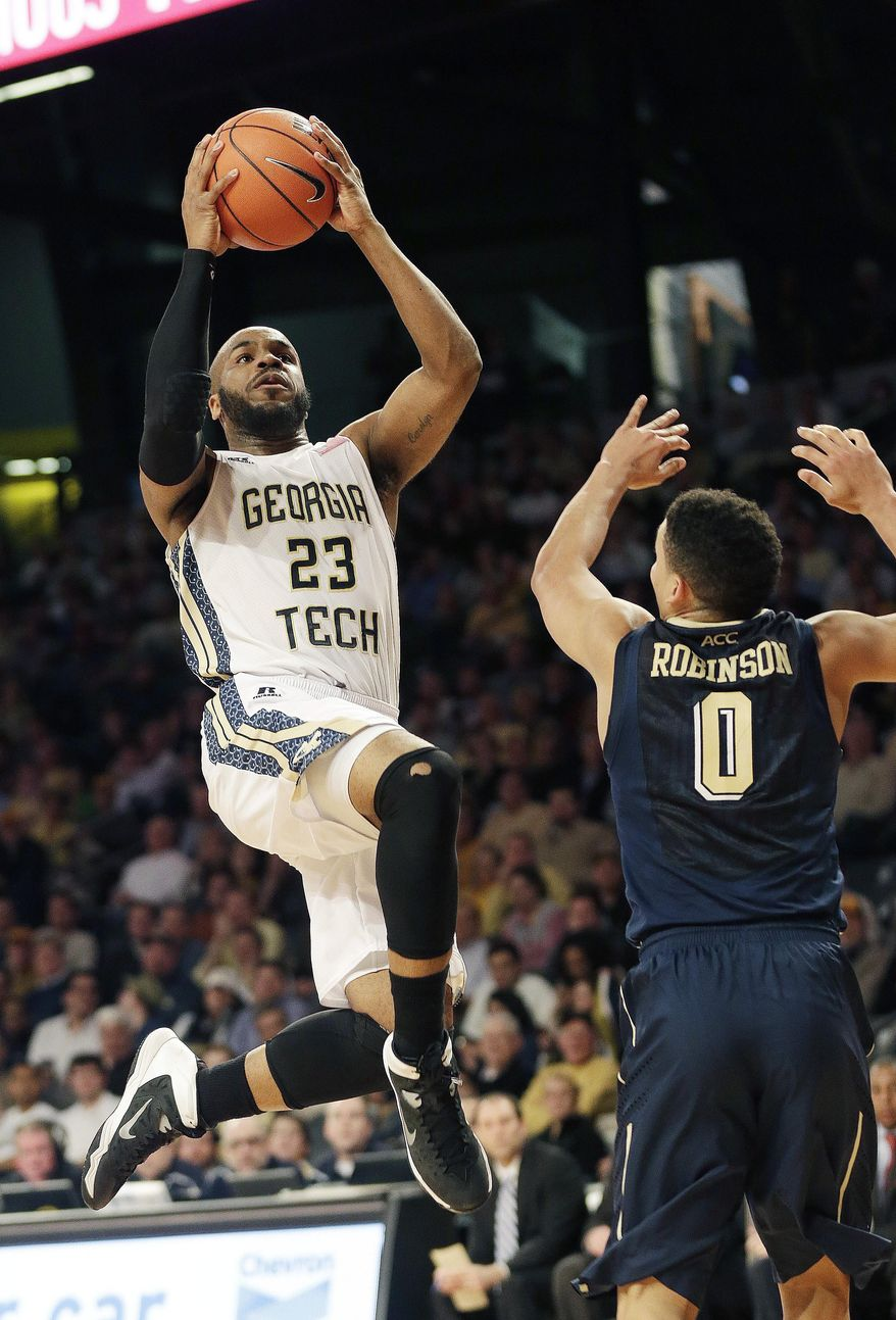 Georgia Tech guard Trae Golden (23) goes up for a shot as Pittsburgh's James Robinson defends in the second half of an NCAA college basketball game, Tuesday, Jan. 14, 2014, in Atlanta. (AP Photo/John Bazemore)