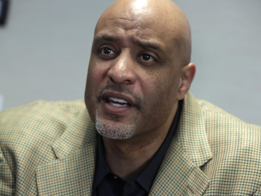 New baseball union head Tony Clark is interviewed at the organization's headquarters, in New York,  Wednesday, Jan. 15, 2014. Clark says players won't agree to terminating contracts as part of discipline for drug violations. Clark took over as the union's executive director following the death of Michael Weiner in November. (AP Photo/Richard Drew)