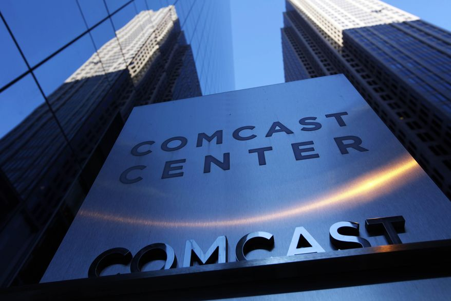 In this Dec. 3, 2009 photo, a sign outside the Comcast Center is shown in Philadelphia. Under so-called net neutrality rules adopted in 2010 by the Federal Communications Commission, wired broadband providers such as Comcast, Time Warner Cable and Verizon were barred from prioritizing some types of internet traffic over others. (Associated Press) **FILE**