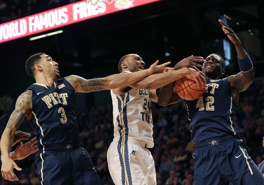 Georgia Tech forward Kammeon Holsey (24) battles Pittsburgh guard Cameron Wright (3) and Pittsburgh forward Talib Zanna (42) for a loose ball in the second half of an NCAA college basketball game, Tuesday, Jan. 14, 2014, in Atlanta. (AP Photo/John Bazemore)
