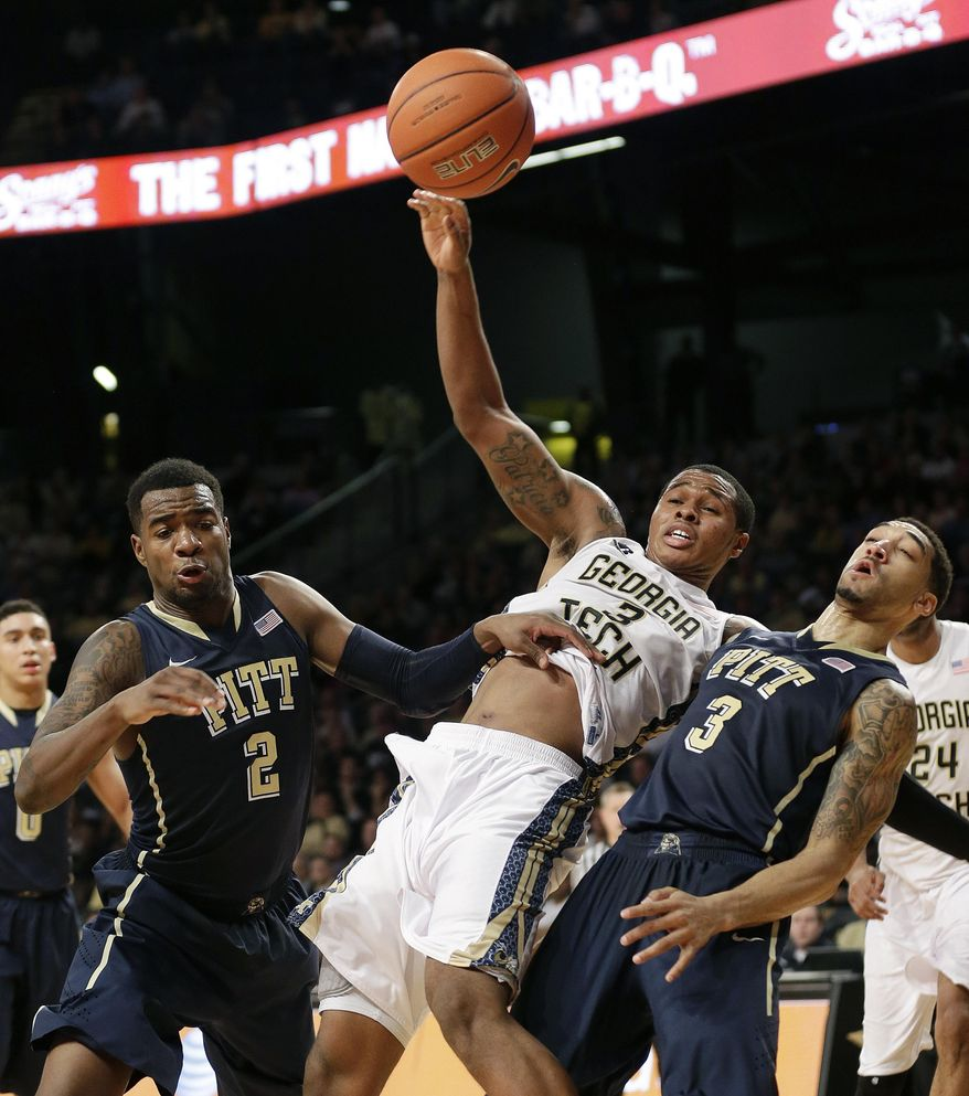 Georgia Tech forward Marcus Georges-Hunt (3) is fouled as Pittsburgh's Michael Young (2) and Cameron Wright, (3), right, defend in the second half of an NCAA college basketball game, Tuesday, Jan. 14, 2014, in Atlanta. (AP Photo/John Bazemore)