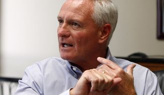 "FILE  - In this April 19, 2013, file photo, Cleveland Browns owner Jimmy Haslam  speaks in Knoxville, Tenn. Amid mounting criticism of Cleveland's coaching search, Haslam says in a letter to fans he's ""committed to finding the right leader for our team."" (AP Photo/Wade Payne, File)"