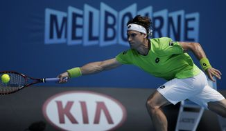 David Ferrer of Spain makes a forehand return to Adrian Mannarino of France during their second round match at the Australian Open tennis championship in Melbourne, Australia, Wednesday, Jan. 15, 2014.(AP Photo/Rick Rycroft)