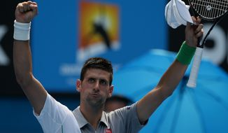 Novak Djokovic of Serbia waves to the crowd after winning his second round match against Leonardo Mayer of Argentina at the Australian Open tennis championship in Melbourne, Australia, Wednesday, Jan. 15, 2014.(AP Photo/Aaron Favila)