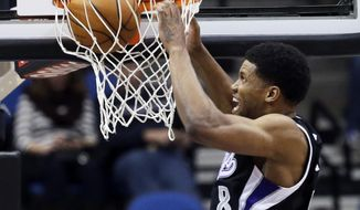 Sacramento Kings' Rudy Gay slams in two points in the first quarter of an NBA basketball game against the Minnesota Timberwolves, Wednesday, Jan. 15, 2014, in Minneapolis. Gay led the Kings with 33 points in their 111-108 win. (AP Photo/Jim Mone)