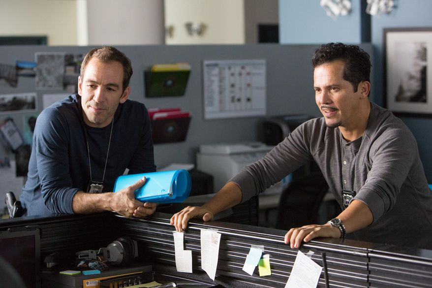 """This image released by Universal Pictures shows Bryan Callen, left, and John Leguizamo in a scene from """"Ride Along."""" (AP Photo/Universal Pictures, Quantrell D. Colbert)"""