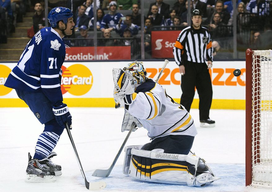 Buffalo Sabres goalie Ryan Miller gets scored on as Toronto Maple Leafs forward David Clarkson, left, looks on during the second period of an NHL hockey game, Wednesday, Jan. 15, 2014 in Toronto. (AP Photo/The Canadian Press, Nathan Denette)