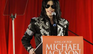 """FILE - In this March 5, 2009 file photo, US singer Michael Jackson speaks at a press conference at the London O2 Arena.  Attorneys for Jackson's estate and Certain Underwriters at Lloyd's of London told a Los  Angeles judge on Wednesday Jan. 15, 2014, that they had resolved a lawsuit over payment of a $17.5 million cancellation and non-appearance insurance policy. The  policy was meant to cover any losses related to Jackson's ill-fated """"This Is It"""" comeback shows scheduled for 2009 in London. (AP Photo/Joel Ryan, File)"""