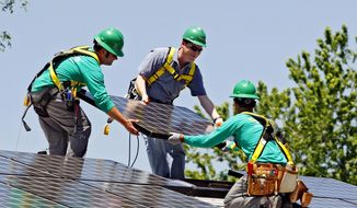 FILE - In this June 18, 2010, file photo, U.S. Senator Michael Bennet, D-Colo., center, helps as Solar City employees Jarret Esposito, left, and Jake Torwatzky, right, install a solar panel on a home in south Denver. The solar panel installer SolarCity said Wednesday, Jan. 15, 2014, it will launch an investment platform that will allow individuals and others to invest in rooftop solar systems directly with SolarCity. (AP Photo/Ed Andrieski, File)