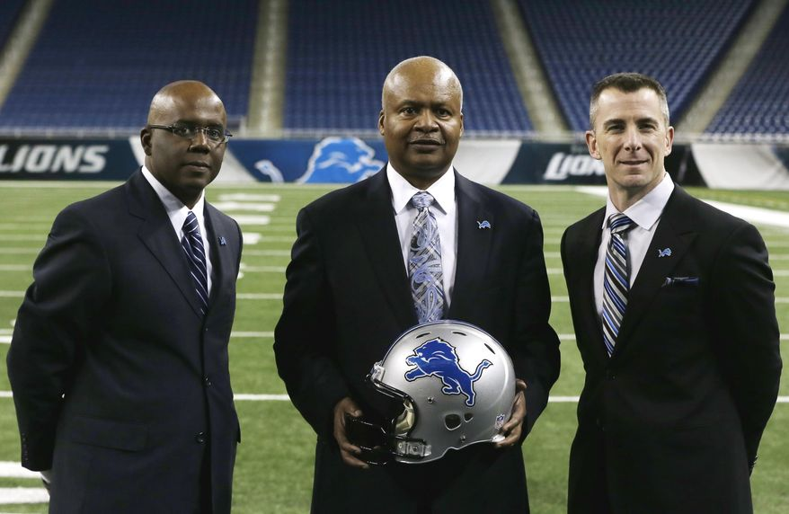 New Detroit Lions head coach Jim Caldwell, center, stands with team president Tom Lewand, right, and General Manager Martin Mayhew at Ford Field in Detroit, Wednesday, Jan. 15, 2014. Caldwell previously was the Baltimore Ravens quarterbacks coach and offensive coordinator. (AP Photo/Carlos Osorio)