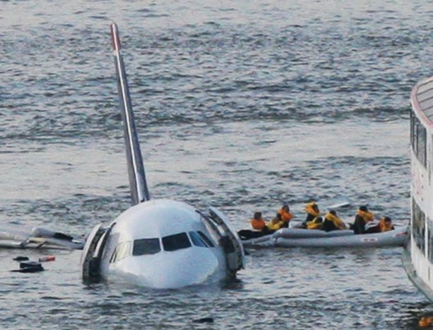 "FILE - In this Jan. 15, 2009 file photo, passengers in an inflatable raft move away from US Airways Flight 1549 that went down in the Hudson River in New York. Capt. Chesley ""Sully"" Sullenberger III, First Officer Jeff Skiles and some passengers who were on the plane on Wednesday, Jan. 15, 2014 are expected to join some of the ferry crews who rescued them from the cold waters five years ago. (AP Photo/Bebeto Matthews, File)"