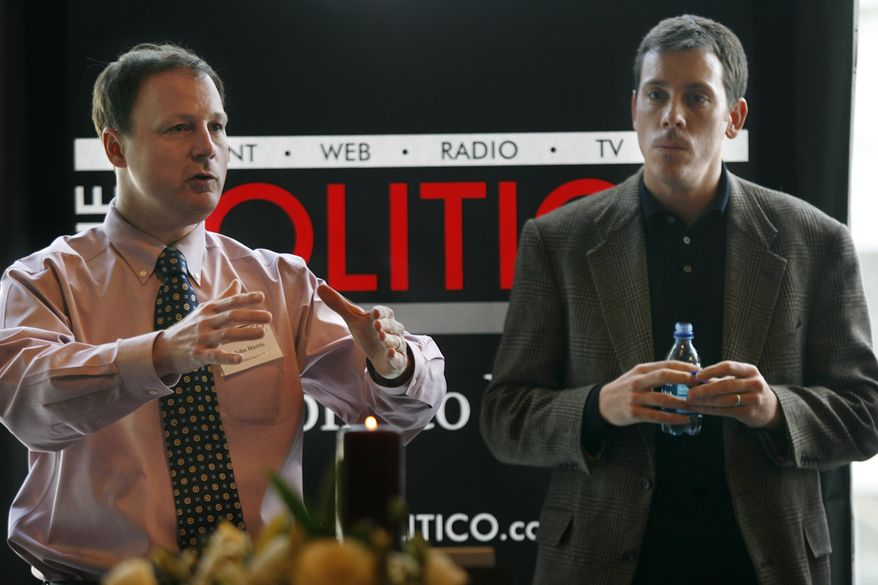 John Harris (left), editor in chief of Politico, and Jim VandeHei, executive editor, speak to advertisers in Arlington, Va., on Jan. 19, 2007. (Associated Press)