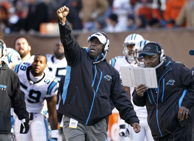 Carolina Panthers defensive line coach Brian Baker calls a play into his team as they take on the Cleveland Browns  in their NFL football game on Sunday, Nov. 28, 2010, in Cleveland.  At right is Carolina Panthers defensive coordinator Ron Meeks.  (AP Photo/Amy Sancetta)