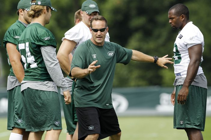 New York Jets special teams assistant coach Ben Kotwica, center, talks to his team during NFL football training camp, Wednesday, Aug. 3, 2011, at Atlantic Health Training Center in Florham Park, N.J. (AP Photo/Julio Cortez)