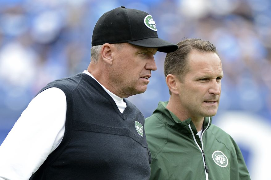 New York Jets head coach Rex Ryan, left, talks with special teams coordinator Ben Kotwica before an NFL football game against the Tennessee Titans on Sunday, Sept. 29, 2013, in Nashville, Tenn. (AP Photo/Mark Zaleski)