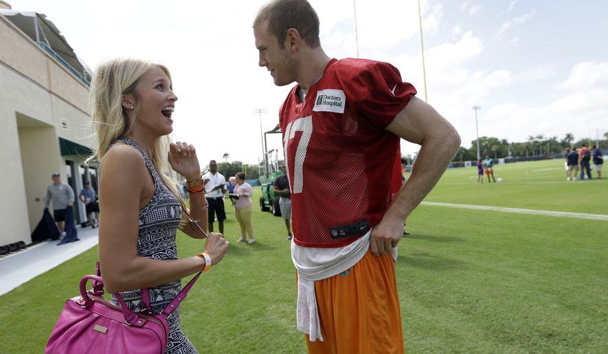 Miami Dolphins' quarterback Ryan Tannehill, right, talks with his wife, Lauren, after an NFL football practice, Monday, July 22, 2013, in Davie, Fla. (AP Photo/Lynne Sladky)