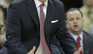 North Carolina State head coach Mark Gottfried directs his team against Wake Forest during the first half of an NCAA college basketball game in Winston-Salem, N.C., Wednesday, Jan. 15, 2014. (AP Photo/Chuck Burton)