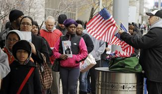 ** FILE ** In this Monday, Nov. 5, 2012, file photo voters wait in line outside the Cuyahoga County Board of Elections in Cleveland on the final day of early voting. (AP Photo/Mark Duncan, File)