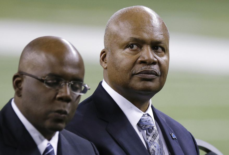 New Detroit Lions head coach Jim Caldwell, right, sits next to General Manager Martin Mayhew at Ford Field in Detroit, Wednesday, Jan. 15, 2014. Caldwell previously was the Baltimore Ravens quarterbacks coach and offensive coordinator. (AP Photo/Carlos Osorio)