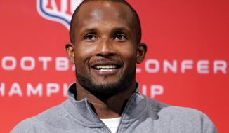 Denver Broncos cornerback Champ Bailey smiles during a news conference at the NFL Denver Broncos football training facility in Englewood, Colo., on Wednesday, Jan. 15, 2014. The Broncos are scheduled to play the New England Patriots on Sunday for the AFC Championship. (AP Photo/Ed Andrieski)