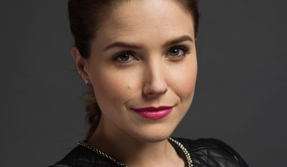 "This Jan. 8, 2014, photo shows American actress Sophia Bush poses during a portrait session to promote her series ""Chicago P.D.,"" in New York. The series airs Wednesdays at 10 p.m. on NBC. (Photo by Scott Gries/Invision/AP)"