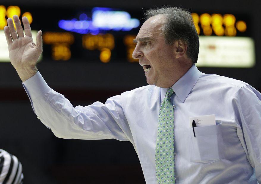 Temple coach Fran Dunphy directs his players in the second half of an NCAA college basketball game against Cincinnati, Tuesday, Jan. 14, 2014, in Cincinnati. Cincinnati won 69-58. (AP Photo/Al Behrman)