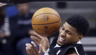Sacramento Kings' Rudy Gay slams in two points in the first quarter of an NBA basketball game against the Minnesota Timberwolves, Wednesday, Jan. 15, 2014, in Minneapolis. (AP Photo/Jim Mone)