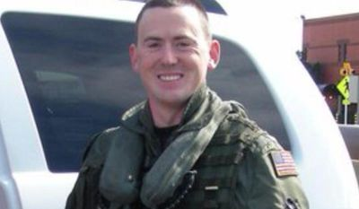 This undated image provided by the U.S. Navy shows pilot Lt. Sean Christopher Snyder. In a news release, the Navy's Fleet Forces Command says divers recovered the body of 39-year-old Lt. Sean Christopher Snyder, of Santee, Calif., on Tuesday, Jan. 14, 2014 a day after locating the helicopter's cockpit. (AP Photo/US Navy)