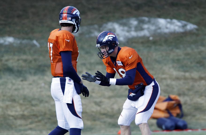 Denver Broncos quarterback Brock Osweiler (17) looks on as Peyton Manning (18) practices taking snaps at the NFL Denver Broncos football training facility in Englewood, Colo., on Wednesday, Jan. 15, 2014. The Broncos are scheduled to play the New England Patriots on Sunday for the AFC Championship. (AP Photo/Ed Andrieski)