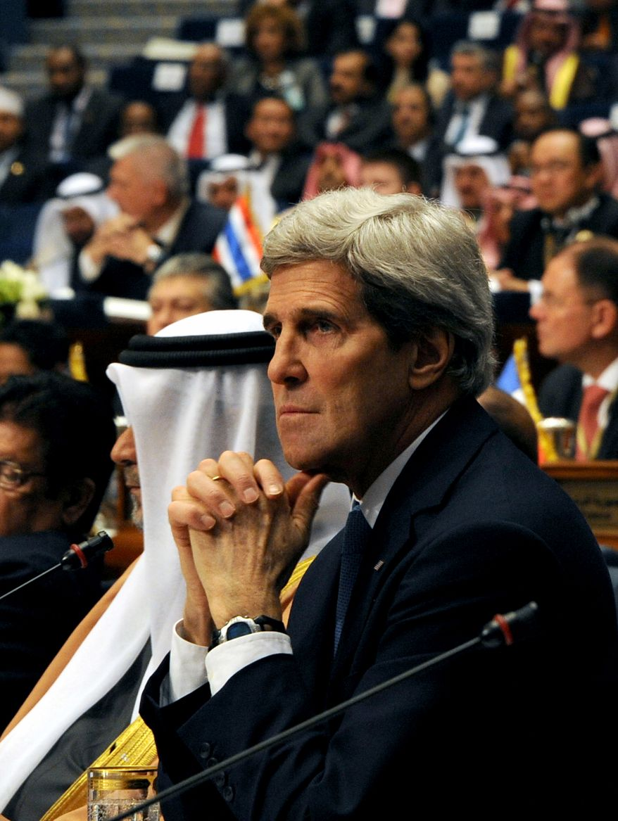 U.S. Secretary of State John Kerry attends the opening session of the second International Humanitarian Pledging Conference for Syria at Bayan Palace, Kuwait City on Wednesday, Jan 15, 2014. Kuwait pledged $500 million and the United States promised $380 million to alleviate the suffering of Syrians affected by the country's civil war at the start of the fundraising conference that international aid officials hope will generate billions of dollars needed this year.(AP Photo/Gustavo Ferrari)