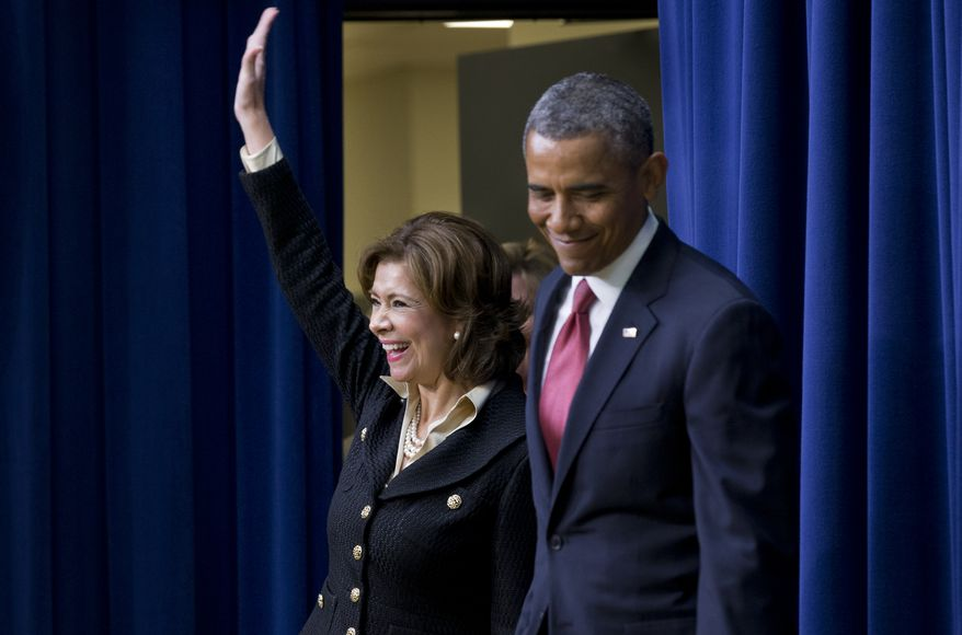 Maria Contreras-Sweet, founder and board chairman of a Latino-owned community bank in Los Angeles, accompanied by President Barack Obama, waves as they enter the South Court Auditorium of the Eisenhower Executive Office Building on the White House complex in Washington, Wednesday, Jan. 15, 2014, where the president announced he would nominate Contreras-Sweet to head the Small Business Administration (SBA) . (AP Photo/Jacquelyn Martin)