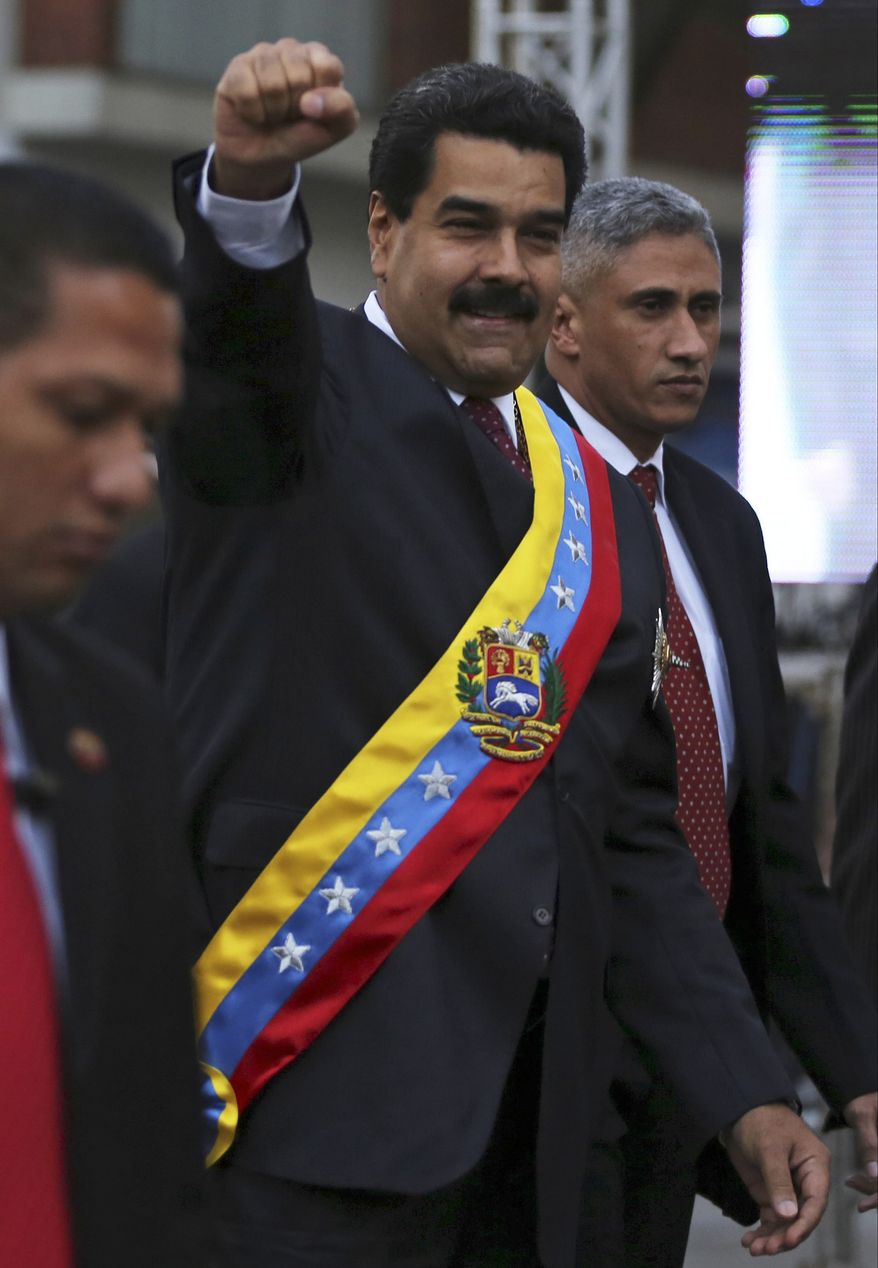 Venezuela's President Nicolas Maduro greets supporters upon his arrival for his annual state-of-the-nation address to National Assembly in Caracas, Venezuela, Wednesday, Jan. 15, 2014. (AP Photo/Fernando Llano)