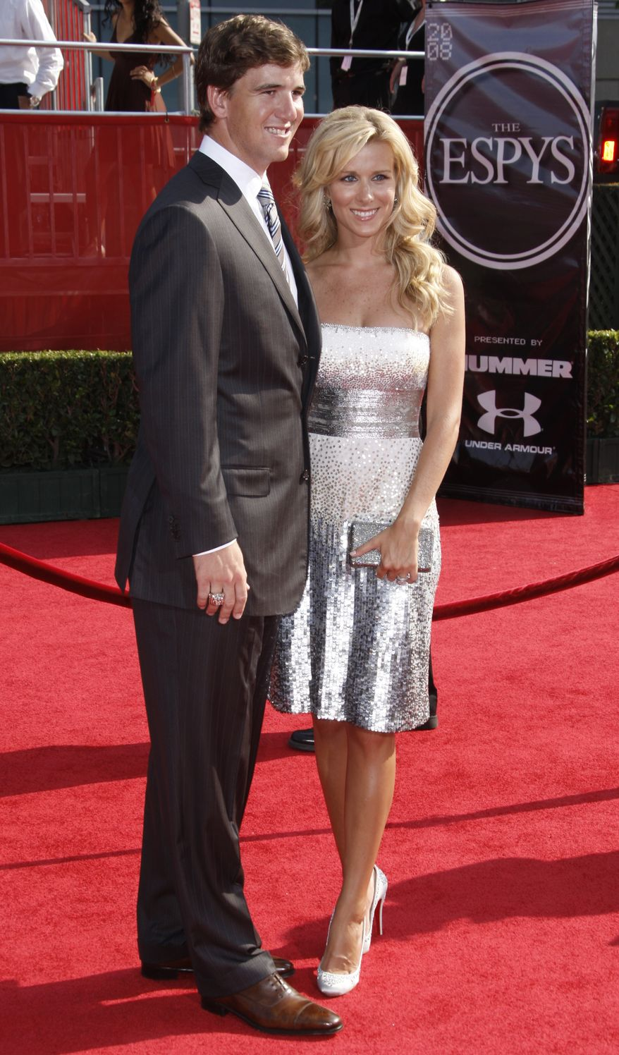 Eli Manning and his wife Abby McGrew arrive at the ESPYs Awards on Wednesday July 16, 2008 in Los Angeles. (AP Photo/Matt Sayles)