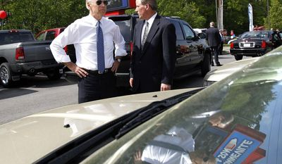 **FILE** Vice President Joseph R. Biden (left) stands with general manager John Berry as he looks over the cars at Bonneville & Son's dealership in Manchester, N.H., on May 25, 2011. (Associated Press)