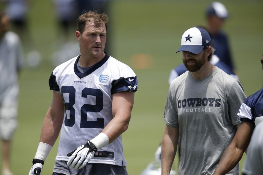 Dallas Cowboys tight end Jason Witten (82) talks with tight ends coach Wes Phillips, right, as they walk off the field at the end of a workout during their NFL football minicamp on Wednesday, June 12, 2013, in Irving, Texas. (AP Photo/Tony Gutierrez)