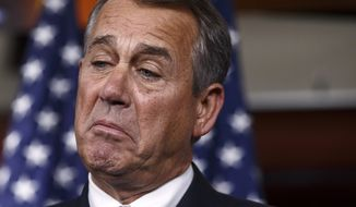 **FILE** House Speaker John Boehner of Ohio pauses while meeting with reporters on Capitol Hill in Washington on Jan. 16, 2014. (Associated Press)