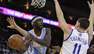 Denver Nuggets' Ty Lawson, left, looks to pass away from Golden State Warriors' Klay Thompson (11) during the first half of an NBA basketball game Wednesday, Jan. 15, 2014, in Oakland, Calif. (AP Photo/Ben Margot)