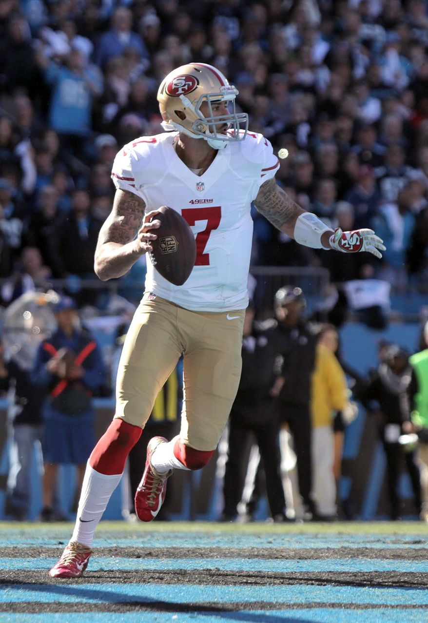 San Francisco 49ers Colin Kaepernick looks to throw out the Carolina Panthers' endzone during a divisional playoff NFL football game, Sunday, Jan. 12, 2014, in Charlotte, N.C. (AP Photo/The Star, Ben Earp)
