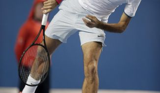 Roger Federer of Switzerland serves to Blaz Kavcic of Slovenia during their second round match at the Australian Open tennis championship in Melbourne, Australia, Thursday, Jan. 16, 2014.(AP Photo/Rick Rycroft)